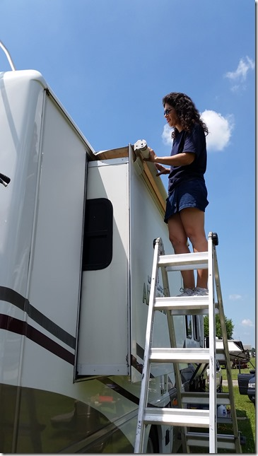 Michelle fixing awning