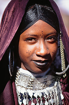 Algeria Tamanrasset Young woman of Tuareg tribe in traditional clothing during the TAFSIT or springfestival