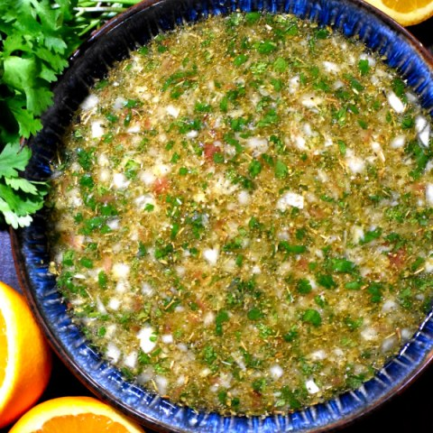 cuban mojo marinade in a blue bowl
