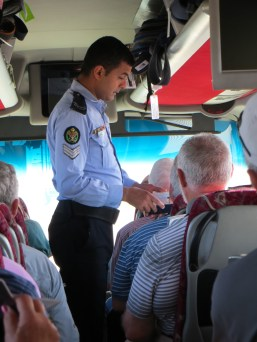 A Jordanian officer on our bus checking all passports