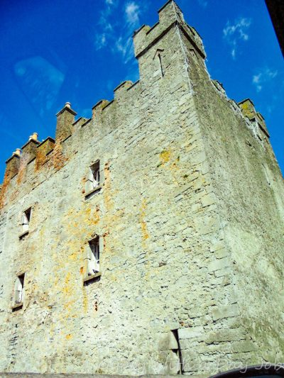 Exploring Irish countryside scenes, white castle.