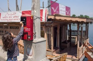 Delivering Love Letters Around the World,Floating Post Office, India.