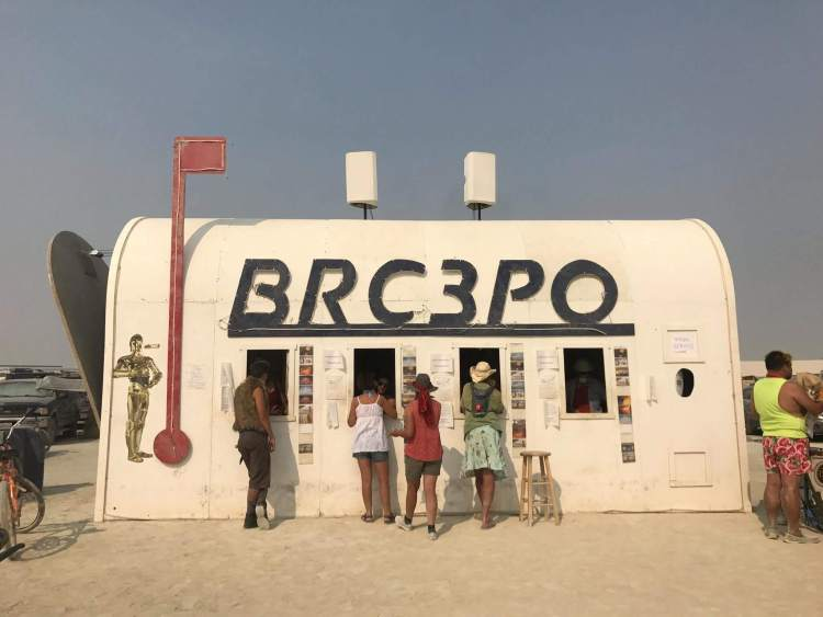Delivering love letters, workers around the world, burning man post office.
