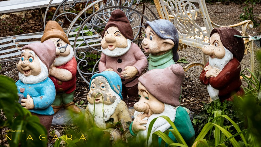 The seven dwarves, statues cast from iron.