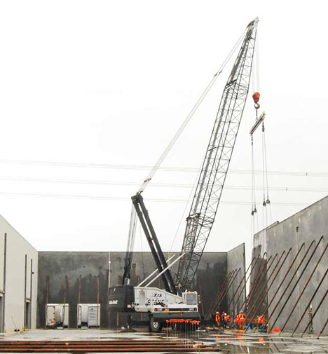Technapack, Hillsboro, crane lifting a concrete wall into place.