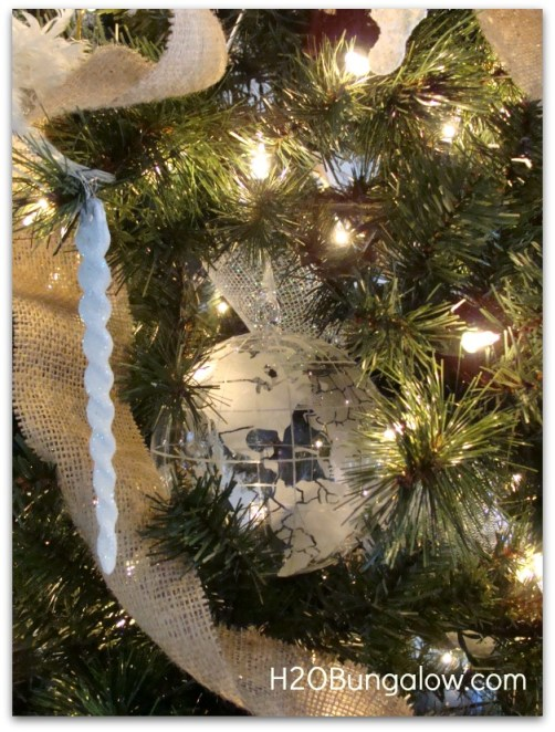 big ornaments are set deep into a professionally decorated tree