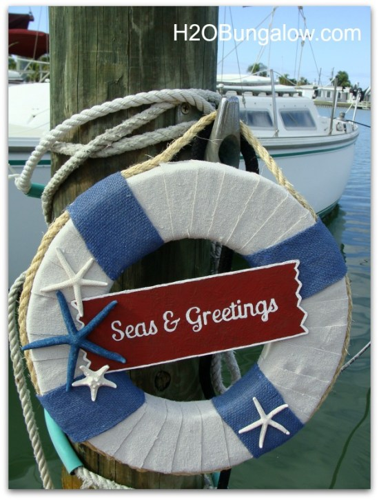 Seas and Greetings DIY Costal Christmas Wreath with tutorial. Hang one on your door and get into the Nautical Christmas spirit this holiday season! www.H2OBungalow #nauticalchristmas