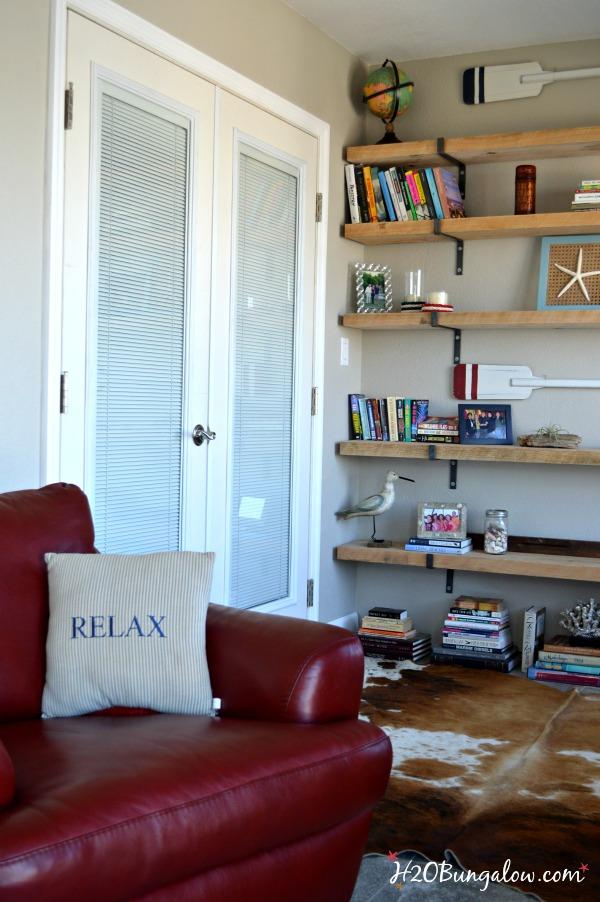 Double-doors-open-bedroom-up-to-outside-veiw-H2OBungalow