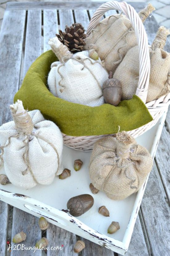 Simple no sew burlap pumpkin tutorial. Whip these darling pumpkins up in no time at all, use as a table decoration, as name tags for place settings or fill a basket for an entryway seasonal vignette. www.H2OBungalow.com #pumpkin #falldecor