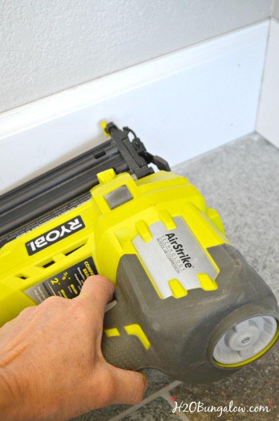 Use a brad nailer to attach baseboards to wall H2OBungalow