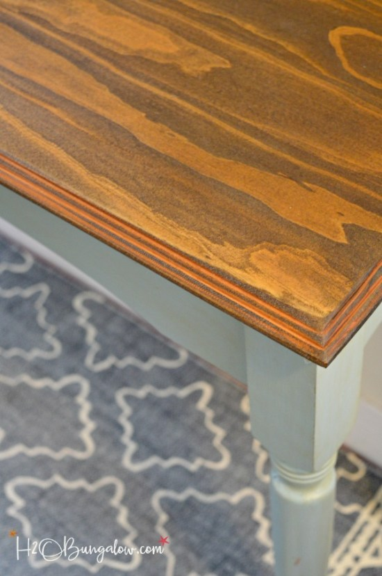 Blue painted console table makeover with Nantucket Blue Reclaim Paint and Glaze with a beautiful stained wood top transformed the old table. by H2OBungalow