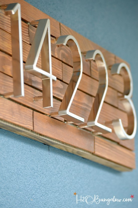 Wood Slat Address Plaque from paint stirrers plus 14 more clever ways to repurpose and upcycle old stuff. DIY project ideas to inspire you to create new uses for old items into pretty and functional home decor.