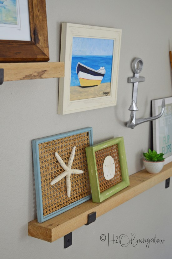 Learn how to style picture ledges in a gallery wall. Use my six steps and tips to create a beautiful themed gallery wall with a mixture of art and other items to add interest. A wall vignette is a fantastic decorating idea and solution for a large blank wall in a room.