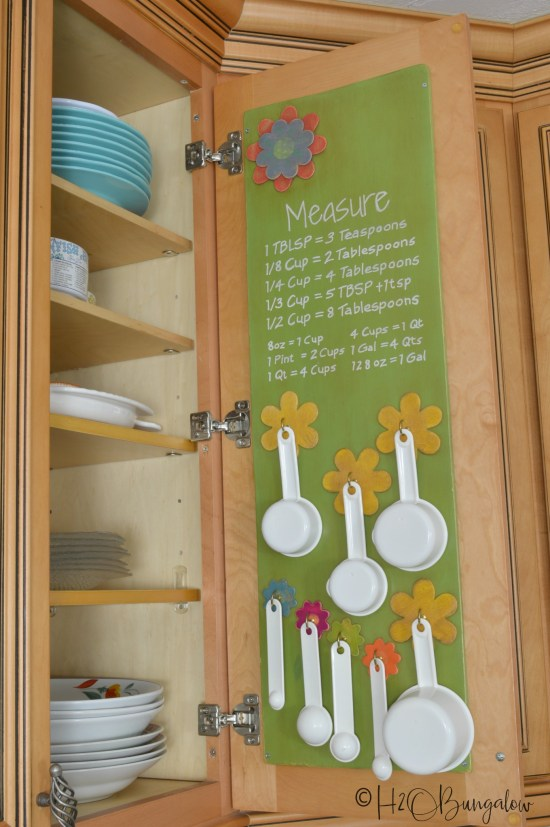How to add more shelves to a kitchen abinet to make more space and make a DIY measuring cup and spoon holder for inside a kitchen cabinet door #organize #organizedkitchen