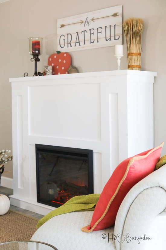 I share plans, a video and a written tutorial to build a DIY fireplace with an electric insert.