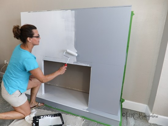 priming and painting DIY fireplace wood frame