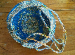Blue plarn basket with hanging strings