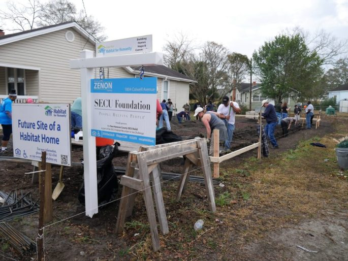 Shortly after the ceremonial groundbreaking, volunteers got busy digging out the ground for the foundation of the house on Colwell Avenue in Wilmington.