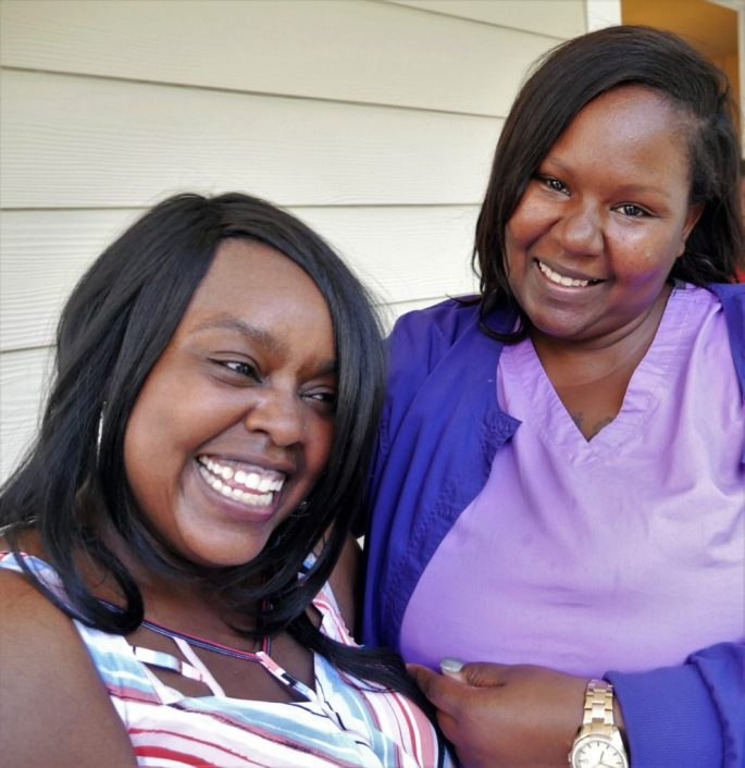 Paditra Carlton, left, enjoys a moment with her friend and fellow Habitat for Humanity client Latasha Wallace.