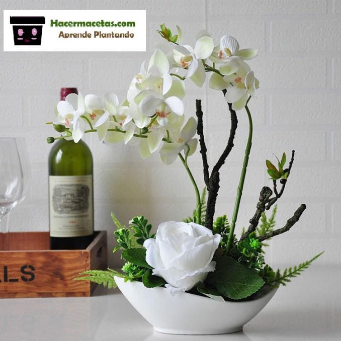 macetas de vidrio y orquidea blanca para decorar