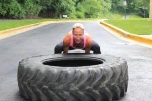 Woman flipping tire