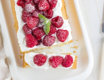 Raspberry cake with cream and fresh raspberries