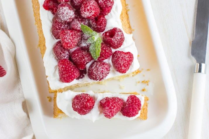 raspberry cake with cream and fresh berries