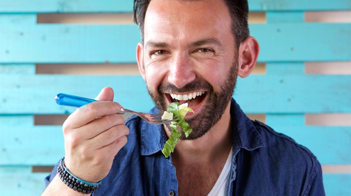 Man eating salad