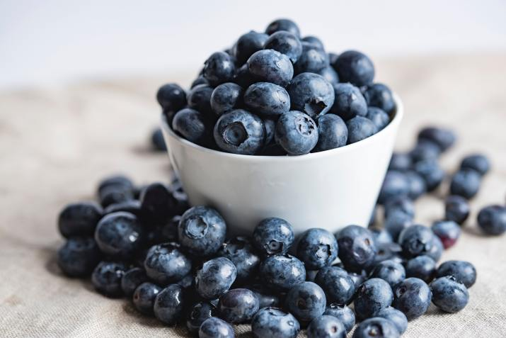 Blueberries overflowing from bowl