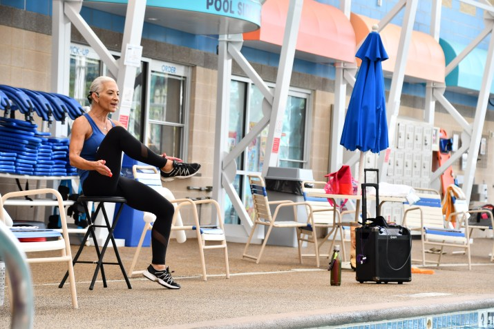 Judy perched on a stool teaching a WATERinMOTION® Platinum class