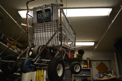 Motorized shopping cart hangs from ceiling