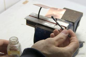 Applying corona dope to a plate's edges