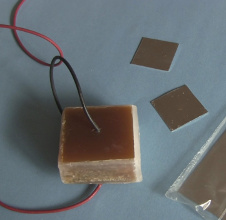 Resin and wax covered capacitor