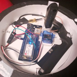 Inside of the sphere sits a Particle Electron, tracker and servo