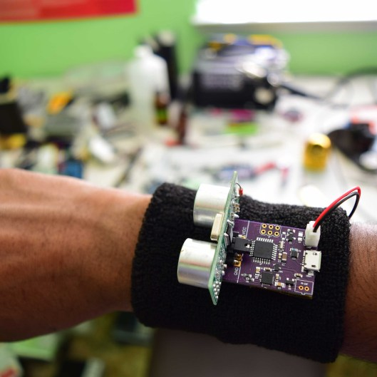 Utrasonic sensors measure the distance to objects, giving haptic feedback to the wearer