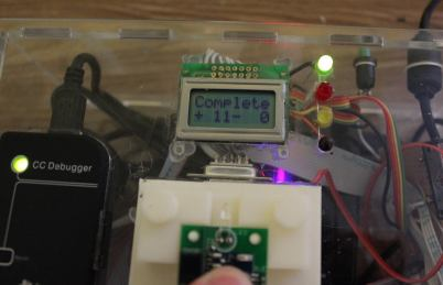 Once complete, the LED changes to Red or Green, and the display updates the success counter.