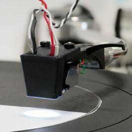 Waveform-disc-being-read-by-light-sensor