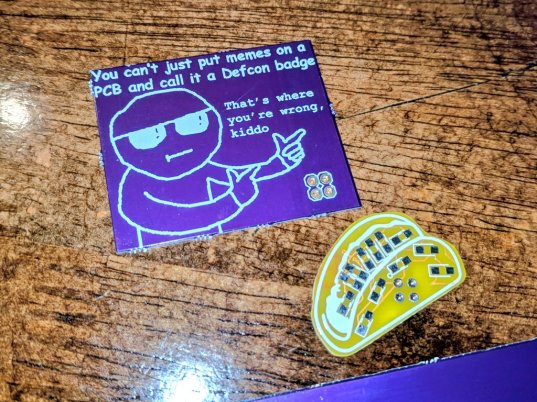 @Borgel's light-up taco add-on, along with the add-on version of Hackaday's official DC25 badge