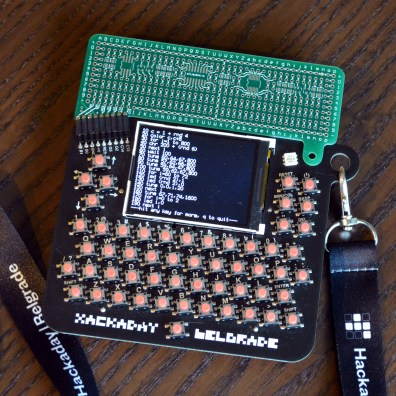 Hackaday Belgrade badge with hardware breakout prototype (production will be black)