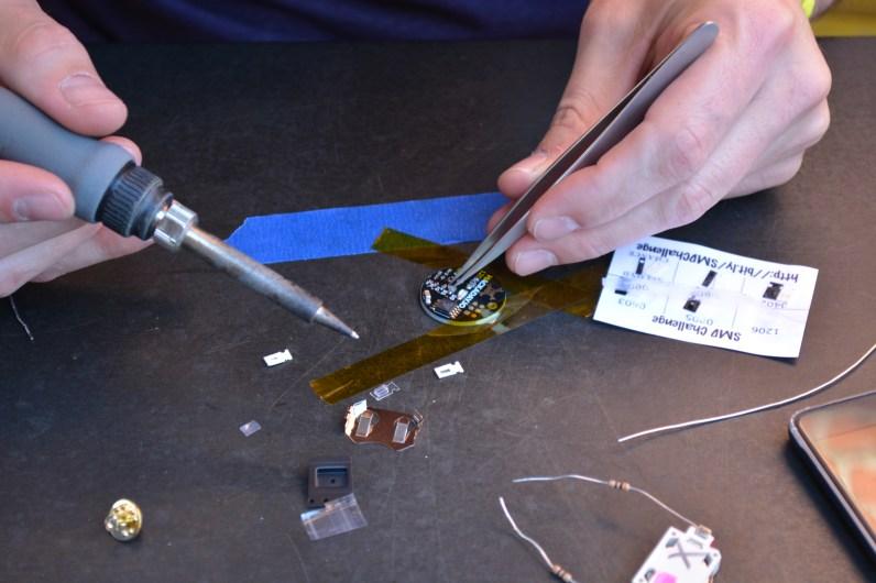 Kapton tape and tweezers at work