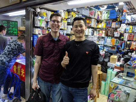 Xuan in front of his shop poses with Mike Szczys