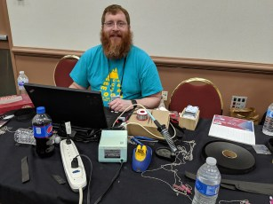 Wire Engineer at his badge repair station