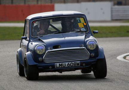 A Mini under cornering forces at Silverstone. Brian Snelson (CC BY 2.0)
