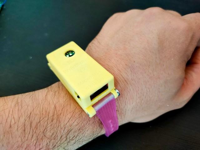 A rectangle-shaped wristband wearable, worn on a wrist