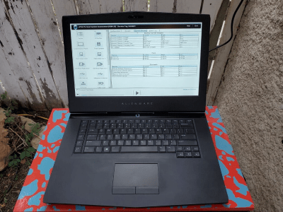An open laptop showing a diagnostic tool on the screen