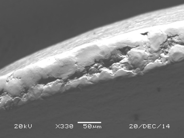 The tip of each thread is just over .06mm, but the edges have obvious surface variation.