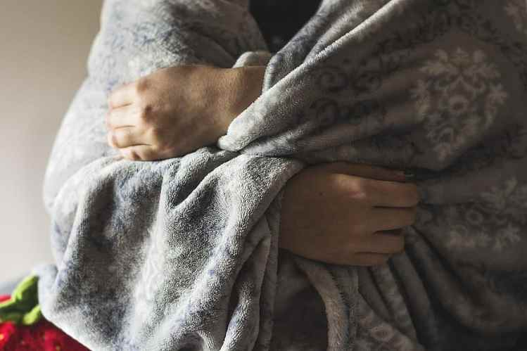 Person wrapped in a blanket