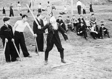 Man Playing a Game of Gorodki
