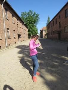 Student, Meredith, taking notes in Auschwitz-1.