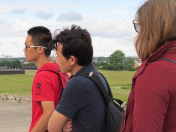 Students, Wei, Chenda and Alexa, listen to our study tour guide at Majdanek.